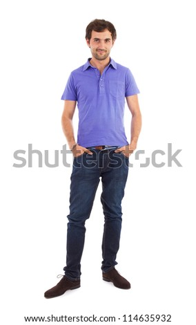 Full length portrait of a caucasian young man with hands in his pockets - stock photo