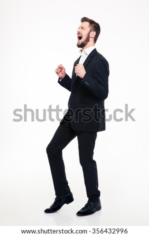 Full length portrait of a cheerful businessman celebrating his success isolated on a white background - stock photo
