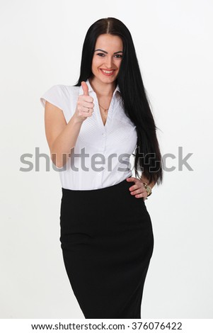 Full length portrait of a cheerful businesswoman pointing finger away camera. Isolated on a white background. Looking at camera - stock photo