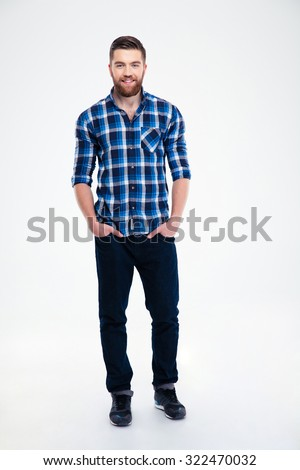 Full length portrait of a cheerful handsome man standing isolated on a white background - stock photo