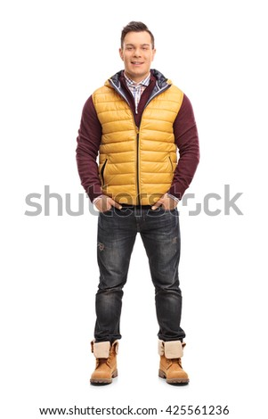 Full length portrait of a cheerful young man in casual winter clothes isolated on white background - stock photo
