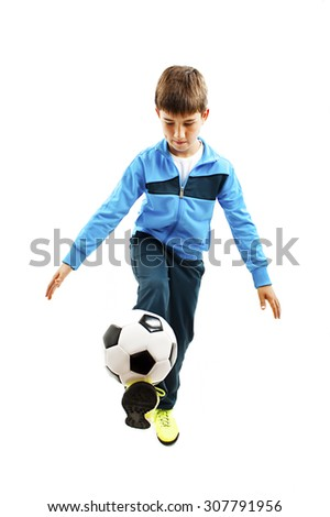 Full length portrait of a child in sportswear jogging with a soccer ball. Isolated on white background - stock photo