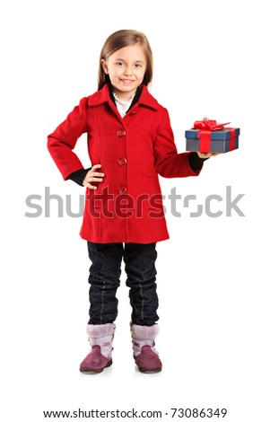 Full length portrait of a child with a gift isolated on white background