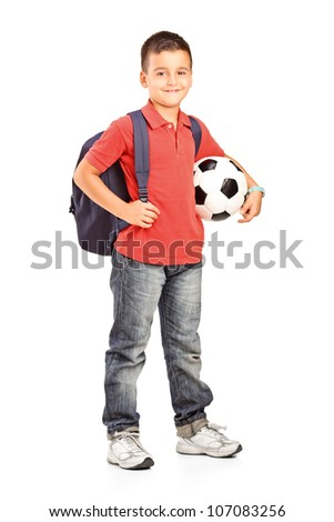 Full length portrait of a child with backpack holding a soccer ball isolated on white background - stock photo