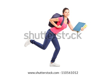 Full length portrait of a college student in a hurry running with notebooks isolated on white background - stock photo