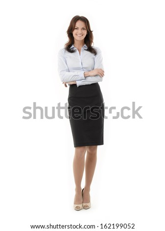 Full Length Portrait Of A Confident Businesswoman. Isolated On A White Background  - stock photo
