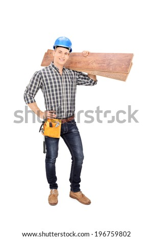Full length portrait of a construction worker holding a couple of planks isolated on white background - stock photo