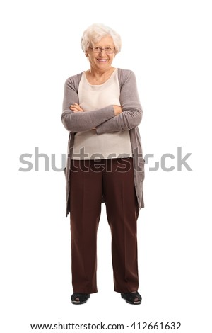 Full length portrait of a content senior lady smiling and looking at the camera isolated on white background - stock photo