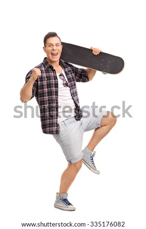 Full length portrait of a delighted male skater holding a skateboard and gesturing happiness isolated on white background