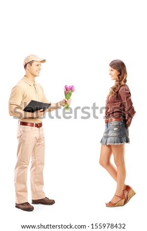 Full length portrait of a delivery boy holding a bunch of flowers and woman isolated on white background