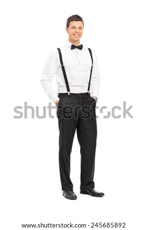 Full length portrait of a fashionable young man with bow-tie posing isolated on white background - stock photo