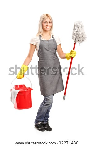 Full length portrait of a female cleaner holding a bucket with cleaning supplies and and floor cleaner isolated on white background - stock photo