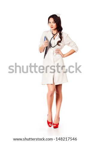 Full length portrait of a female medical employee standing with a clipboard. Isolated over white. - stock photo