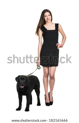 Full length portrait of a female walking her dog isolated on white background - stock photo
