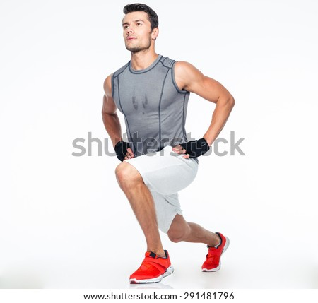 Full length portrait of a fitness man stretching isolated on a white background - stock photo