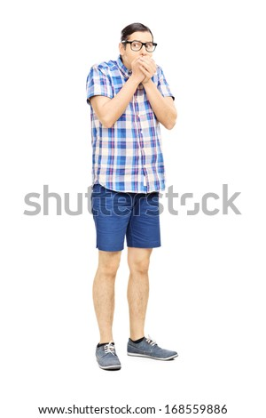 Full length portrait of a frightened young man looking isolated on white background - stock photo