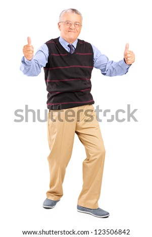 Full length portrait of a gentleman giving thumbs up isolated on white background - stock photo