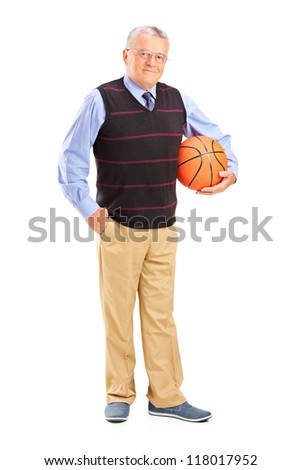 Full length portrait of a gentleman holding a basketball isolated against white background - stock photo
