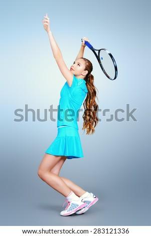 Full length portrait of a girl tennis player in motion. Studio shot. - stock photo