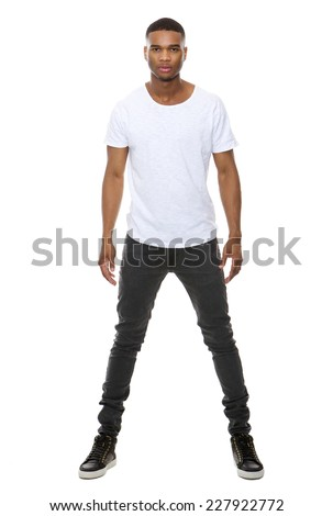 Full length portrait of a handsome african american male fashion model posing on isolated white background  - stock photo
