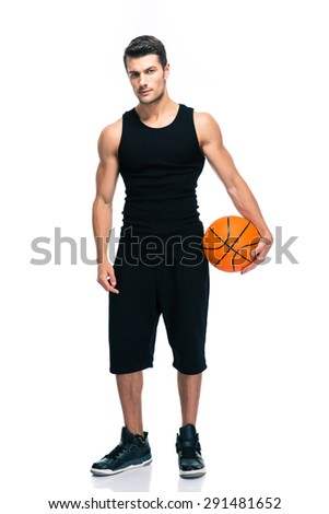 Full length portrait of a handsome basketball player standing isolated on a white background. Looking at camera