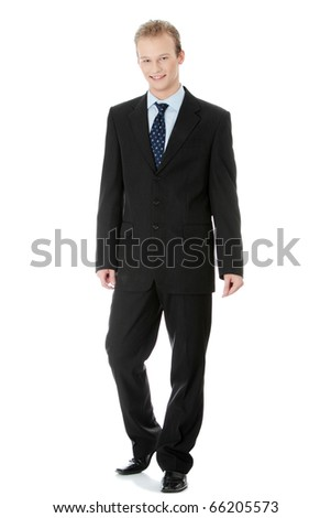Full length portrait of a handsome business man standing against white background - stock photo