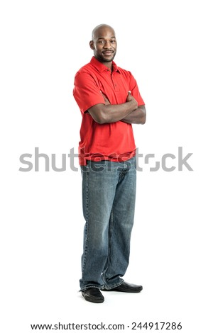 Full length portrait of a handsome late 20s black man looking to the side isolated on white background - stock photo