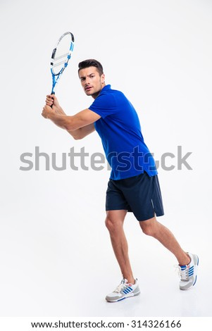 Full length portrait of a handsome man playing in tennis isolated on a white background - stock photo