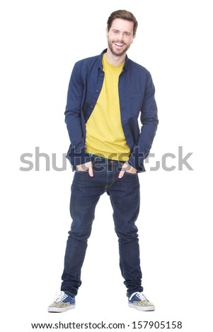 Full length portrait of a handsome young man smiling against isolated white background
