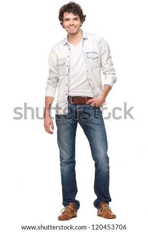 Full length portrait of a handsome young man smiling. Isolated on white background. He has his hand in his pocket - stock photo