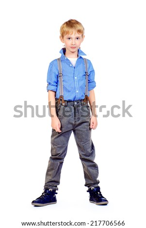 Full length portrait of a happy boy smiling at camera. Isolated over white. - stock photo