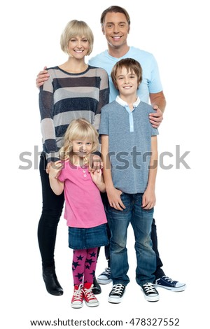 Full length portrait of a happy family posing in trendy