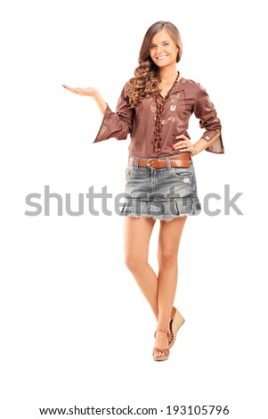 Full length portrait of a happy fashionable female gesturing with hand isolated on white background - stock photo