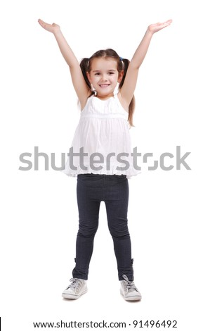 Full length portrait of a happy little girl standing with hands raised on white background - stock photo