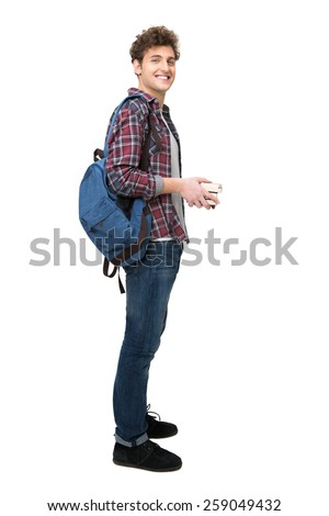 Full length portrait of a happy male student over white background - stock photo