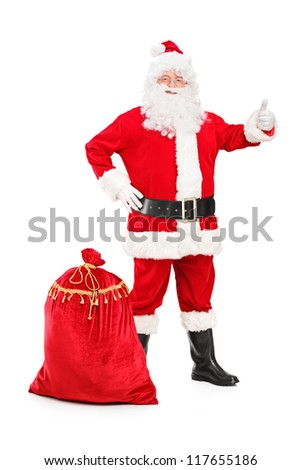 Full length portrait of a happy Santa Claus with a bag giving a thumb up isolated on white background - stock photo