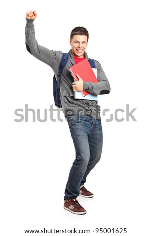 Full length portrait of a happy student holding books isolated on white background