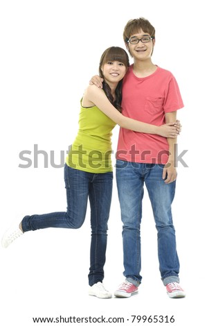 Full length portrait of a happy young couple hugging