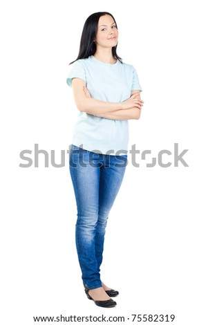 Full length portrait of a happy young female standing with folded hand against white background - stock photo