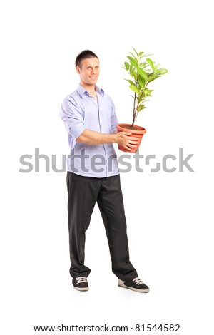 Full length portrait of a happy young man holding a pot with decoration plant isolated on white background - stock photo
