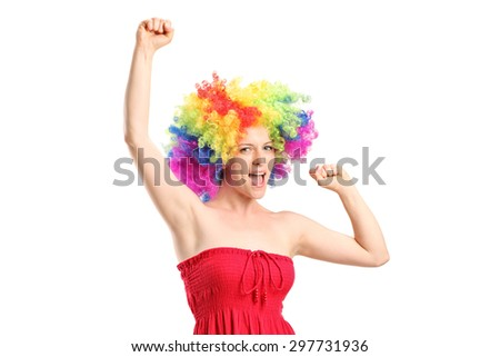 Full length portrait of a happy young woman with a wig gesturing joy isolated on white background