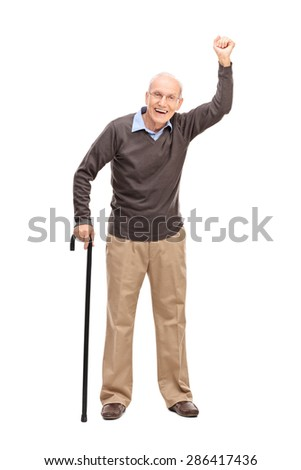Full length portrait of a joyful senior gesturing with his hand in the air isolated on white background  - stock photo