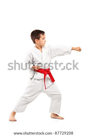 Full length portrait of a karate child posing isolated on white background