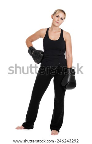 Full length portrait of a late 20s beautiful woman kickboxer athlete wearing boxing gloves isolated on a white background - stock photo
