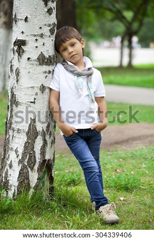 Full length portrait of a little boy in the summer park - stock photo