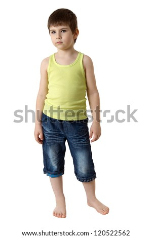 Full length portrait of a little boy standing on white background - stock photo