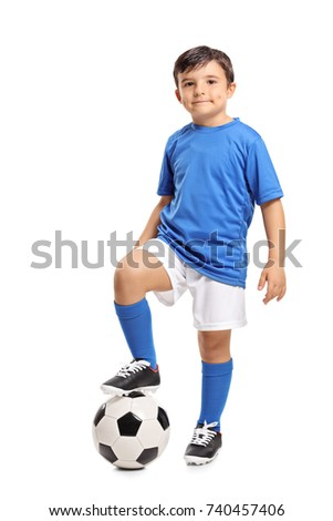 Full length portrait of a little footballer isolated on white background
