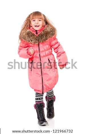 Full length portrait of a little girl dressed with winter clothes isolated on white background - stock photo