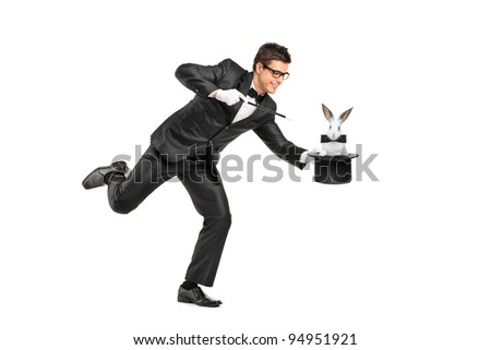 Full length portrait of a magician holding a top hat with a rabbit on it isolated on white background - stock photo
