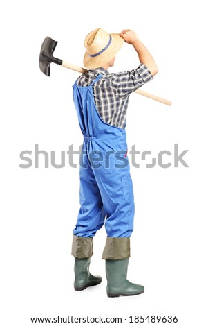Full length portrait of a male agricultural worker holding a shovel isolated on white background, rear view